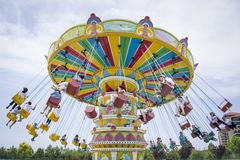 The amusement park Swing rides. Traditional swing at amusement park Stock Photo