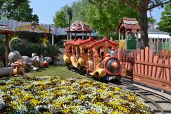 Amusement park train. The train for children in the amusement park stock photos