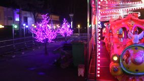 Amusement park - train. Amusement park train and lights colorful flashing stock video footage