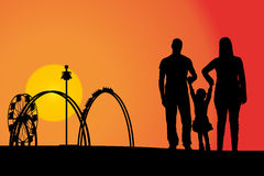 Amusement park. Vector silhouette amusement park at sunset with people Stock Photos