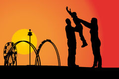 Amusement park. Vector silhouette amusement park at sunset with people Stock Image
