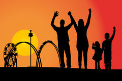 Amusement park. Vector silhouette amusement park at sunset with people Royalty Free Stock Image