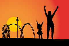 Amusement park. Vector silhouette amusement park at sunset with people Royalty Free Stock Images