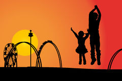 Amusement park. Vector silhouette amusement park at sunset with people Royalty Free Stock Photos