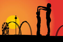 Amusement park. Vector silhouette amusement park at sunset with people Royalty Free Stock Photo