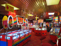 Slot machines in an arcade. An amusement parlor or arcade with various slot machines for fun in an English seaside resort Royalty Free Stock Photo