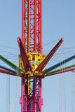 Amusement ride. Details of colorful modern amusement ride with blue sky background Royalty Free Stock Images