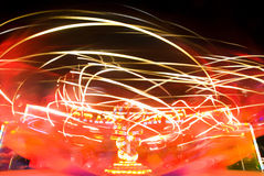 Amusement ride. Blur neon lights in amusement park, long exposure Royalty Free Stock Photography
