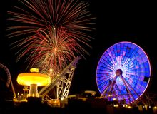 Amusement Ride & Fireworks. Amusement ride in motion at night with fireworks Royalty Free Stock Photos