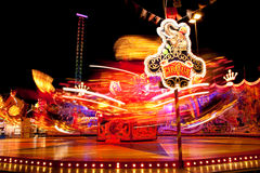 Amusement Ride at Night. Colorful amusement ride in motion at night, taken with long exposure. Ride is part of a traveling circus in Frankfurt-am-Main, Germany royalty free stock photo