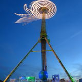 Amusement ride rotation blur at blue hour Stock Photos