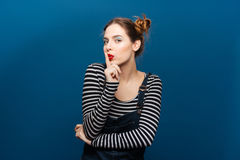Amusing attractive young woman showing silence gesture Royalty Free Stock Photos