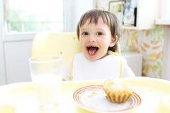 Amusing baby having dinner Royalty Free Stock Image