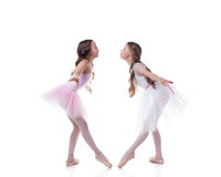 Amusing ballerinas posing looking at each other Stock Images