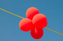 Amusing balls and yellow ribbon in the sky. Royalty Free Stock Images