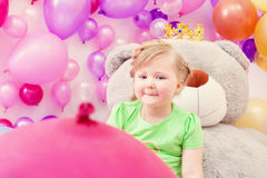 Amusing blonde girl posing in playroom Stock Photos