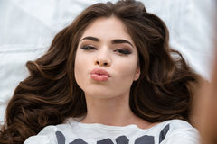 Amusing charming woman taking selfie and making duck face Royalty Free Stock Image