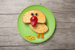 Amusing chicken made of bread and cheese royalty free stock image