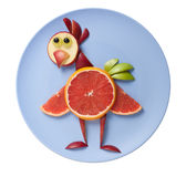Amusing chicken made of fruits stock images