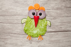 Amusing chicken made of vegetables on table stock photo
