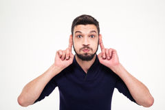 Amusing comic young bearded man making funny face Royalty Free Stock Photography