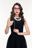 Amusing curly woman posing with fake beads and glasses booth Royalty Free Stock Image