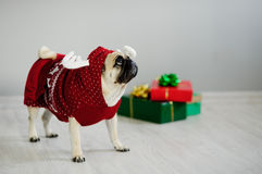 The amusing doggy of breed pug is dressed by a holiday in reindeer suit. Royalty Free Stock Photo