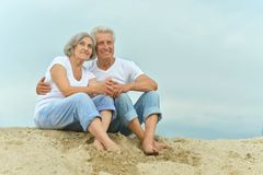 Amusing elderly couple on the beach Royalty Free Stock Photo