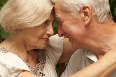 Amusing elderly couple sitting on the veranda Stock Photography