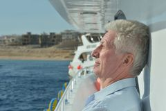 Amusing elderly man. Have a ride in a boat on sea royalty free stock image