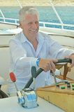 Amusing elderly man. Have a ride in a boat on sea royalty free stock photos