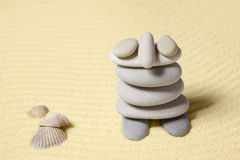 Amusing figure of man from pebble on sand Stock Photos