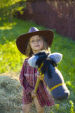 Amusing five-year cowboy with a horse Royalty Free Stock Photography