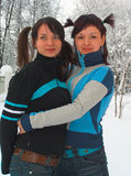 Amusing girl-friends. Girls with tails Stock Image