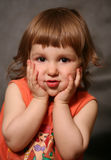 Amusing grimace. Portrait of the two-year-old girl with an amusing grimace stock photos