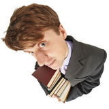 Amusing guy with library books in hands. The amusing guy with library books in hands on a white background royalty free stock photos
