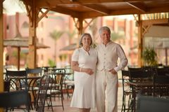 Amusing old couple at cafe. Amusing happy smiling old couple at cafe Royalty Free Stock Photos