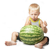 Amusing kid and the big green water-melon Royalty Free Stock Photo