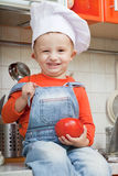 Amusing kid in a cook cap Stock Photos