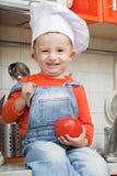 Amusing kid in a cook cap Stock Photos