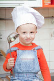 Amusing kid in a cook cap Stock Photo