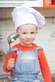 Amusing kid in a cook cap Stock Photo