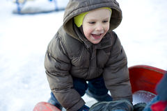 Amusing kid who plays at a playground Stock Images