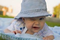 Amusing kid winks Stock Image