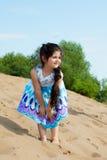 Amusing little model posing on beach Stock Images