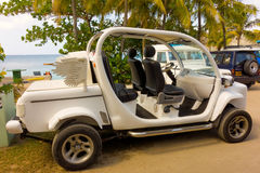 An amusing motorized buggy at a beach in the tropics Royalty Free Stock Images