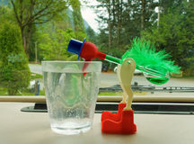 An amusing novelty demonstrating thermodynamics. A fun, colorful bird displaying scientific properties on the dashboard of a parked motor-home Royalty Free Stock Image