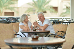 Amusing old couple at cafe table Stock Photos