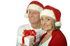 Amusing old couple  with gift Royalty Free Stock Images
