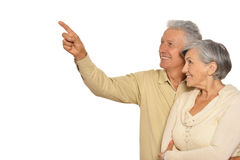 Amusing   old couple. Amusing happy smiling old couple,man pointing by his hand Stock Images